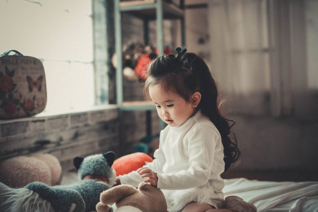 little girl playing in play room